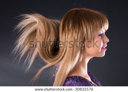 Special hairstyle. Young woman profile portrait. - stock photo