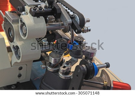 Special machine for winding wire on a toroidal transformer - stock photo