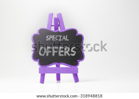 Special offers text on blackboard isolated on white background - stock photo