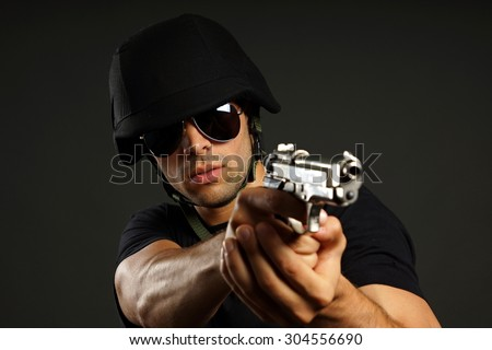 Special ops officer SWAT in black uniform - stock photo
