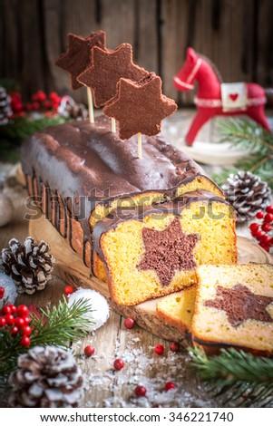 Special original christmas cake with chocolate icing - stock photo