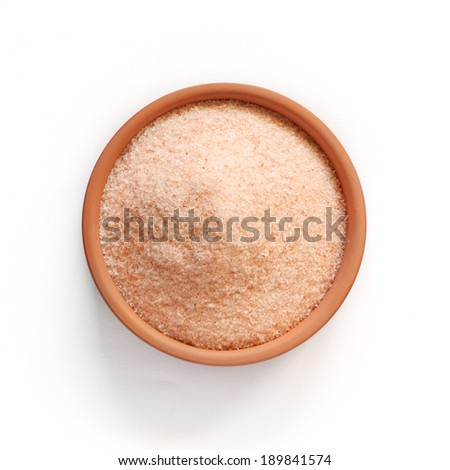 Special pink salt from the Himalayas, in a small bowl isolated on white. - stock photo
