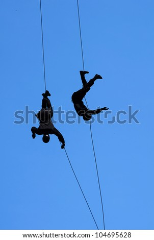 Special police force show tehnique landing with cable - stock photo