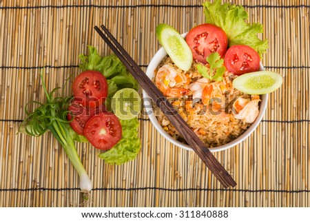 Special Shrimp fried rice in white cup on table with wooden background - stock photo