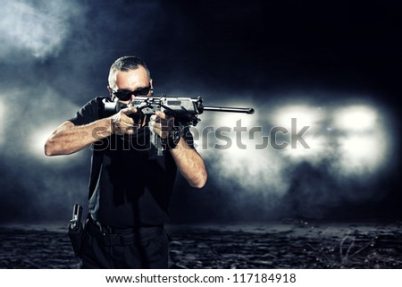 special  tactics man holding up his weapon