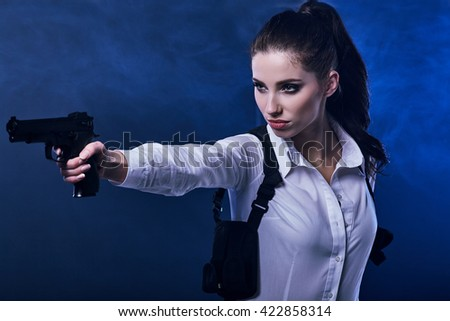 special tactics sexy woman holding up her weapon - stock photo