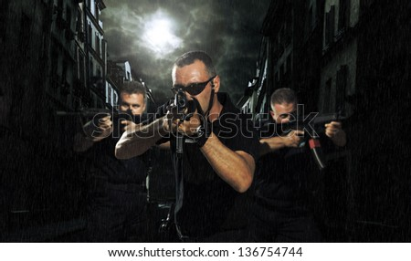 special tactics team ready for action in the streets - stock photo