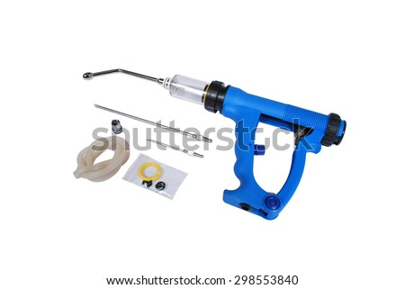 Special tools for veterinarians. A gun for injection Cattle with accessory: tubing, needles on a white background - stock photo