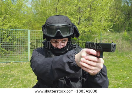 Special unit policeman with a gun - stock photo