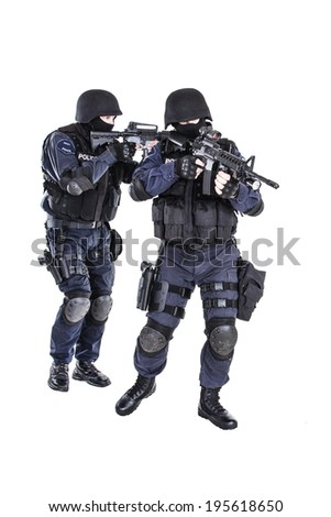 Special weapons and tactics SWAT team in action - stock photo