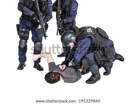 Special weapons and tactics SWAT team makes a bust - stock photo