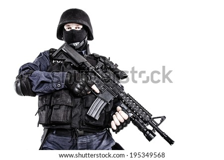 Special weapons and tactics SWAT team officer with his gun - stock photo