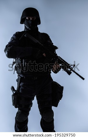 Special weapons and tactics team SWAT officer silhouette - stock photo
