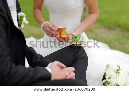 Special wedding toast with cups, focused to green cup - stock photo