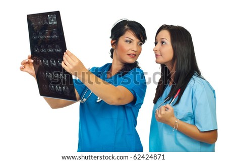 Specialist doctor showing and teaching her medical student about magnetic resonance isolated on white background - stock photo