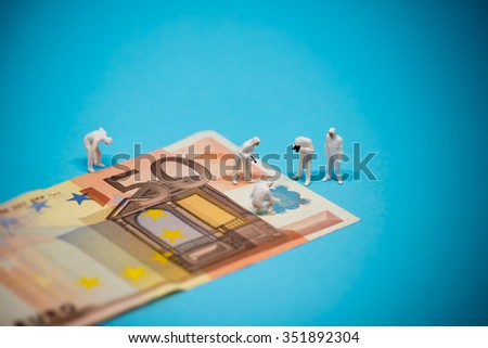 Specialists inspecting 50 euro banknote. Fraud concept. Macro photo - stock photo