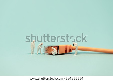 Specialists with network cable. Macro photo - stock photo