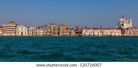 Specific image of traditional houses near the Grand Canal in Venice, Italy.