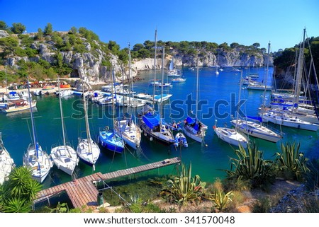 Specific image with narrow canal called calanque and sail boats near Cassis, France - stock photo