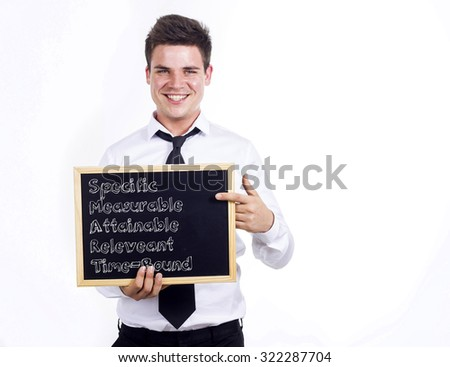 Specific Measurable Attainable Releveant Time-Bound SMART - Young smiling businessman holding chalkboard with text