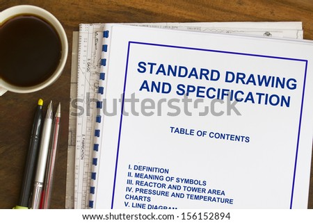 specification drawing and standards plans with coffee and blueprints - stock photo
