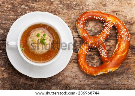 speckknoedel, a tyrolean dumpling in broth  - stock photo