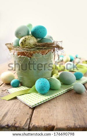 Speckled eggs  in bowl for Easter - stock photo