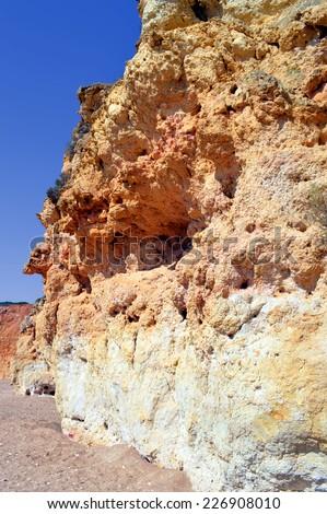 Spectacular cliffs on Senhora Da Rocha Nova Beach in Portugal - stock photo