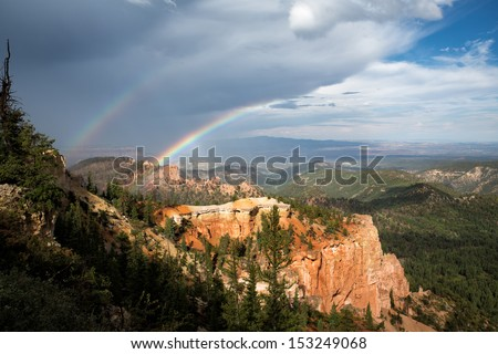 spectacular double rainbow in Bryce Canyon National Park, southwestern Utah, a unique place on Earth. Its large collection of delicate, rocky, colorful formations are called hoodoos. - stock photo