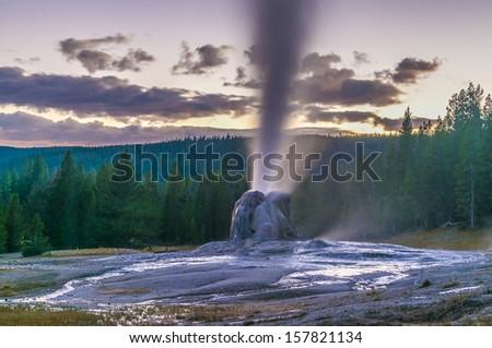 Spectacular Lone Star Geyser during Eruption - Yellowstone - stock photo