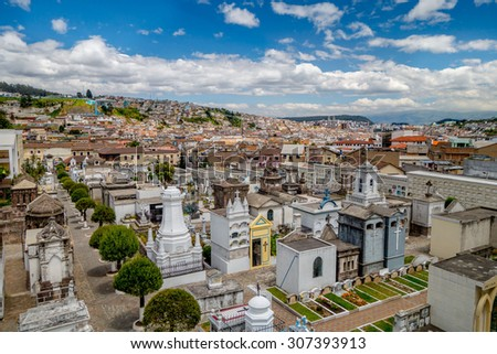 Spectacular overview of cemetary San Diego showing typical catholic graves with large gravestones and old city background.