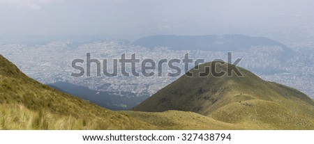Spectacular panoramic view of Quito from the mountain, the capital of Ecuador in the background. - stock photo