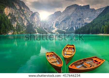 Spectacular romantic place with typical wooden boats on the alpine lake,(Lago di Braies) Braies lake,Dolomites,South Tyrol,Italy,Europe - stock photo
