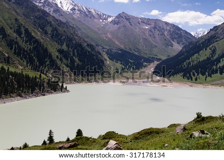 Spectacular scenic Big Almaty Lake ,Tian Shan Mountains in Almaty, Kazakhstan, Central Asia - stock photo