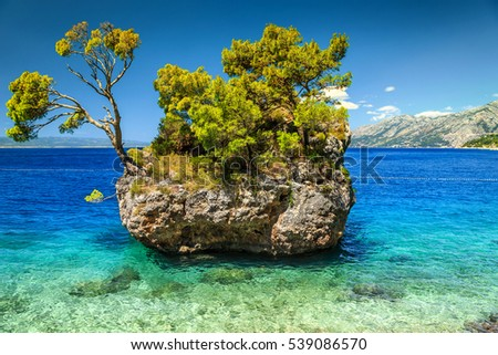 Spectacular summer landscape with rocky island and clean water on the beach, Brela, Makarska riviera, Dalmatia, Croatia, Europe