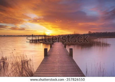Spectacular sunrise over a lake near Amsterdam in The Netherlands. - stock photo