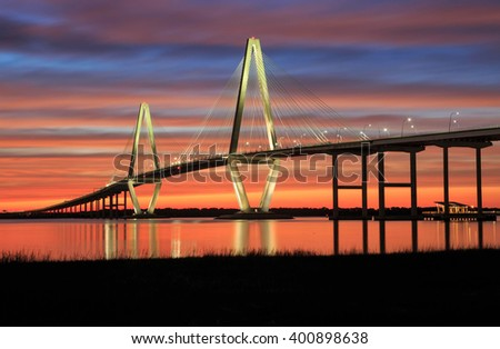 Spectacular sunset over the new cable-stayed Cooper River bridge, also known as the Ravenel, in Charleston, South Carolina.