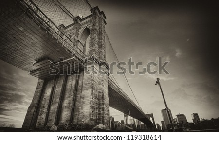 Spectacular view of Brooklyn Bridge from Brooklyn shore at winter sunset - New York City - stock photo