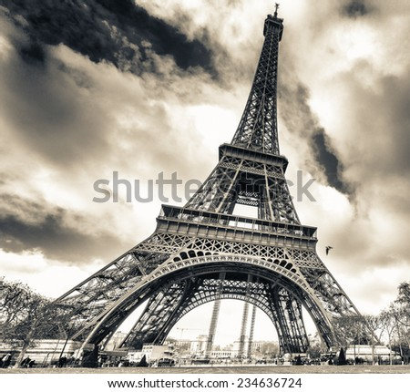 Spectacular view of Tour Eiffel structure on a beautiful sunny day. Eiffel Tower under blue sky, Paris. - stock photo