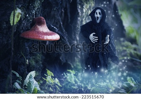 specter of death in the enchanted forest, halloween - stock photo
