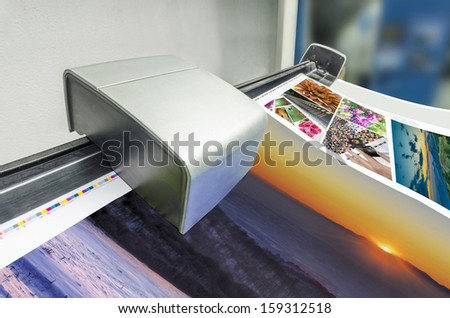 Spectrophotometer color control unit of fountain keys at offset printing machine. Color management process - stock photo