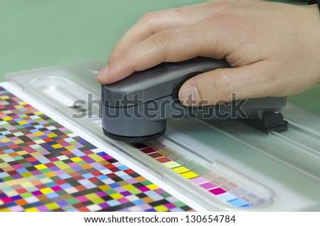 spectrophotometer verify color patches on Test Arch, Press shop prepress department - stock photo