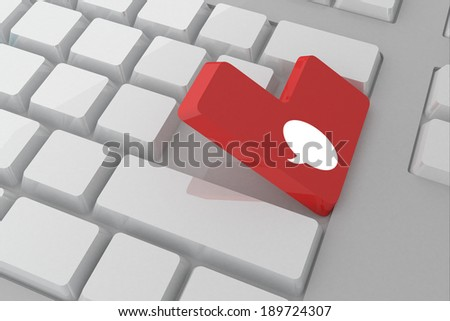 Speech bubble against white keyboard with red key