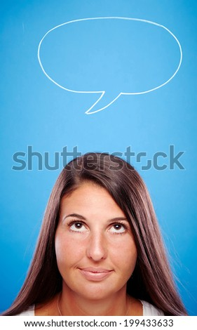 Speech Bubble - Hand drawn speech bubble on a blue background, young female looking at it.