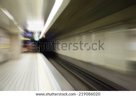 Speed blur of subway track in tunnel for train. - stock photo