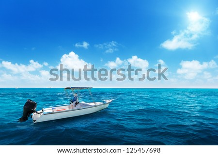 speed boat and water of indian ocean - stock photo