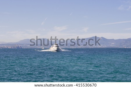 Speed Boat at Lake Garda Italy. Speed boat with underwater wings, operated by Gestione Navigazione Laghi, at Lake Garda harbor in Bardolino (Veneto, Italy). Lake voyage from Bardolino to Sirmione. - stock photo