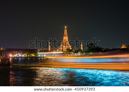 Speed boat light Temple of dawn or Wat Arun with speed of boat at night