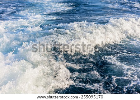 Speed boat wake in the sea. This is the view behind a speed boat. - stock photo