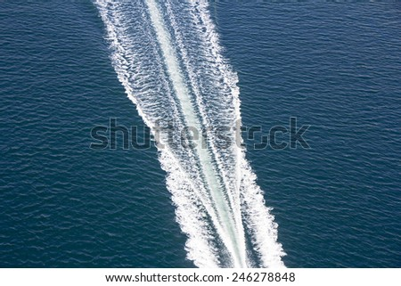 Speed boats trace on the blue sea  - stock photo